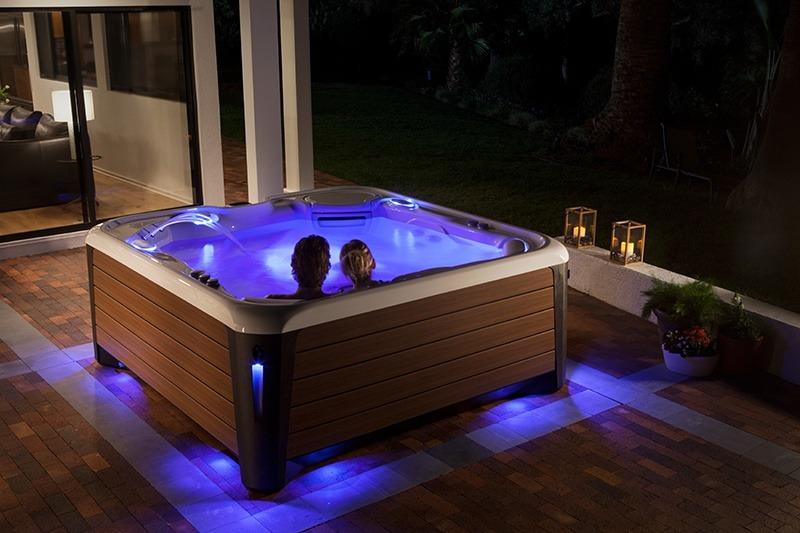 Premium hot tubs feature LED light displays in brilliant colors.