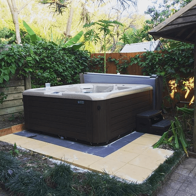 Let plants, trees, and bushes create a private haven around your home spa.