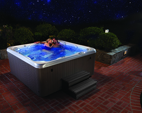 couple relaxing and enjoying a soak on a beautiful starlit evening